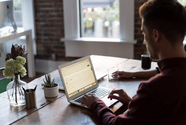 Ecommerce store owner on laptop optimising his brand game