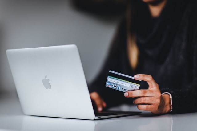 Girl doing payment for her online purchase